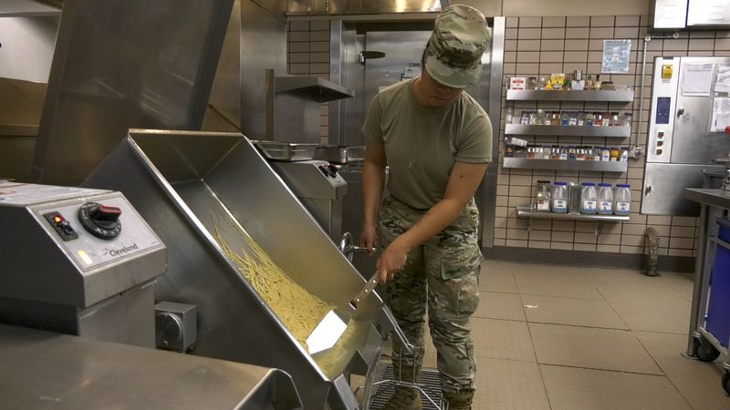 An Eielson Air Force Base Airman prepares food for the lunch rush at the base. During Red Flag...