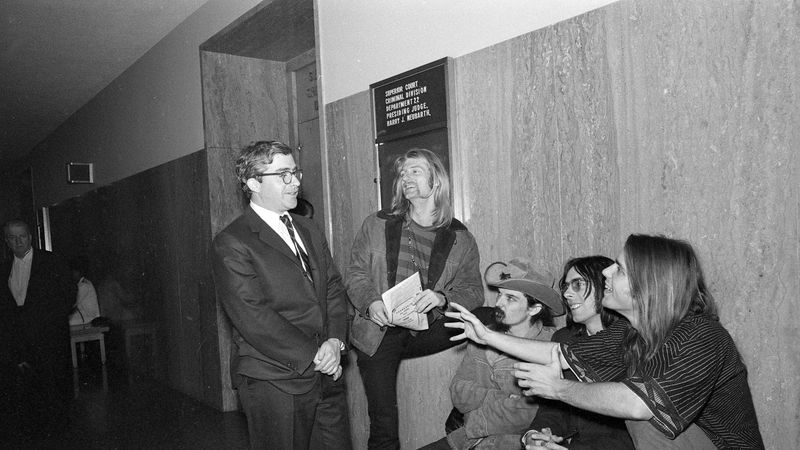 Attorney Brian Rohan, left, confers with members of the Grateful Dead on June 23, 1968, at...