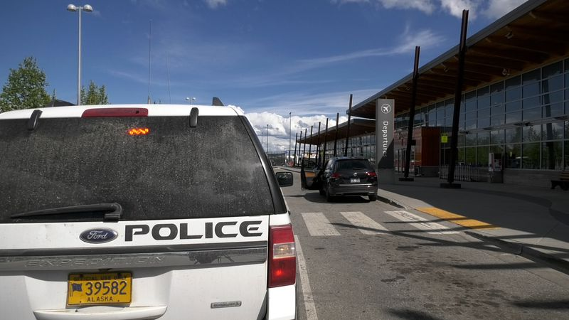 A Fairbanks International Airport Police and Fire vehicle is parked in the concourse of FAI....