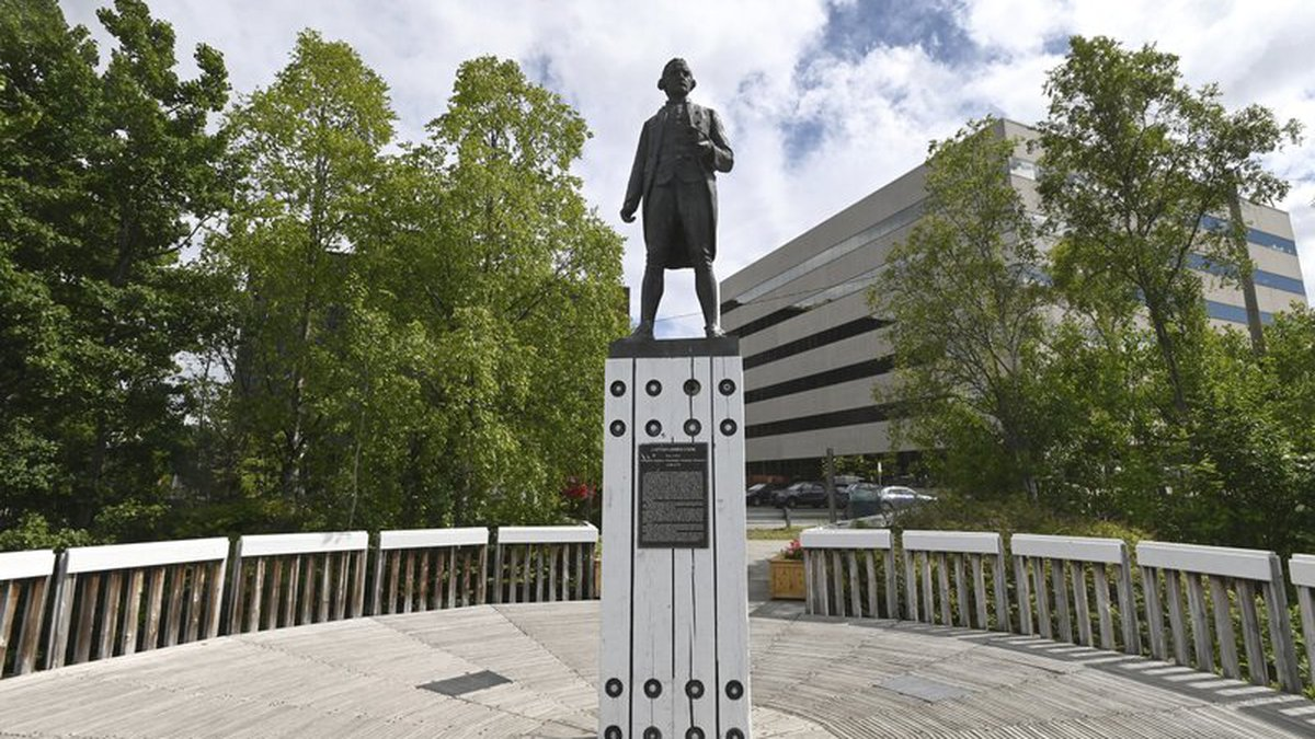 In this Wednesday, June 17, 2020 photo, a statue of Captain James Cook stands on a plinth in...