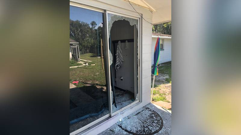 A shattered sliding-glass door is seen in a photo shared by the Polk County Sheriff's Office of...