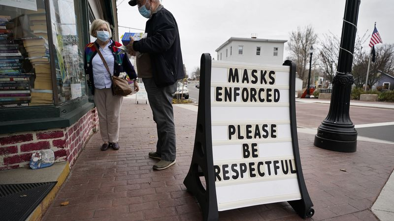 Shoppers comply with the mask regulations to help prevent the spread of the coronavirus at...