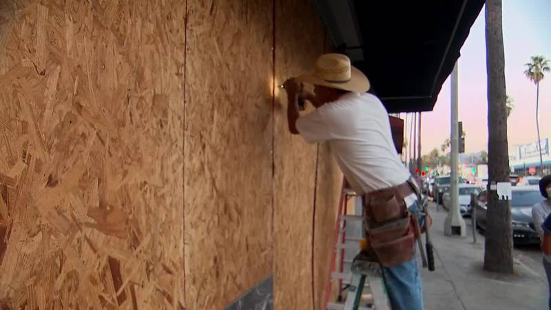 Businesses in Los Angeles are among those boarding up in advance of potential unrest related to...