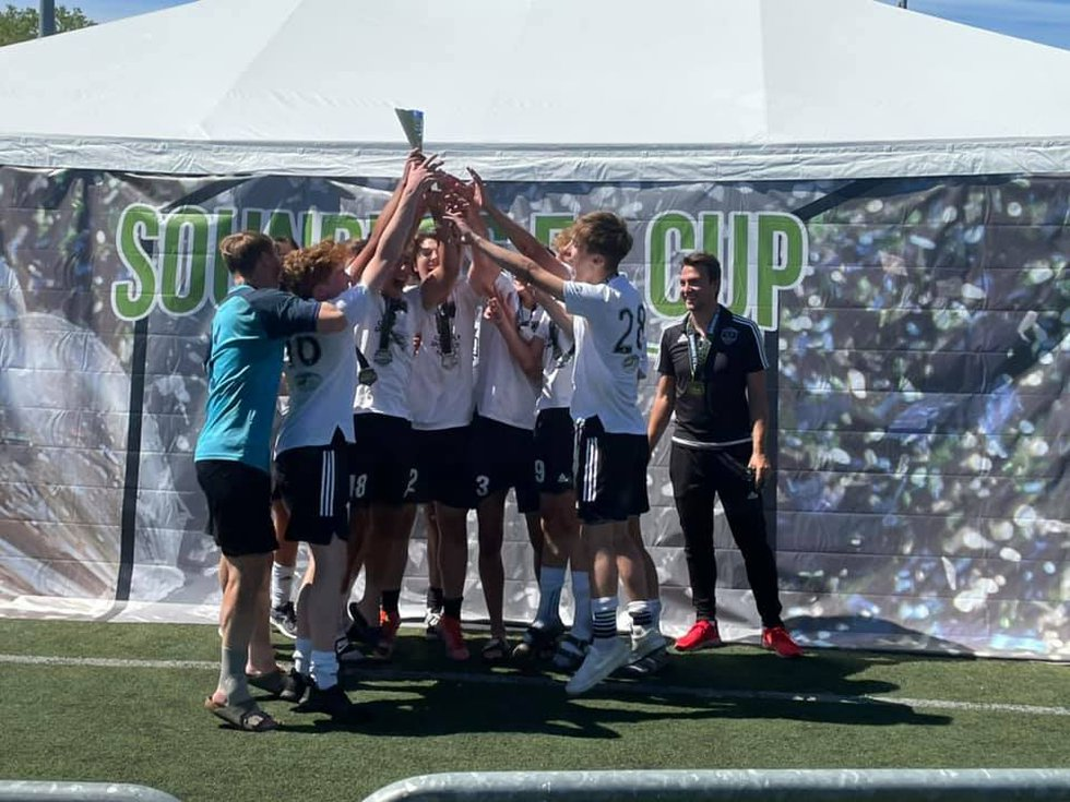 Eclipse Soccer 03-04 Boys celebrate the championship at the Sounders FC Cup in Tukwila,...