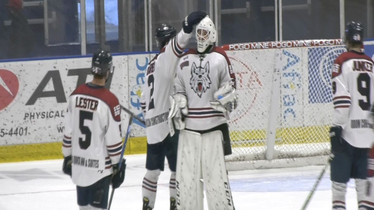 Captain Andrew Garby shows love to goaltender Kayden Hargraves during the Ice Dogs' home opener...
