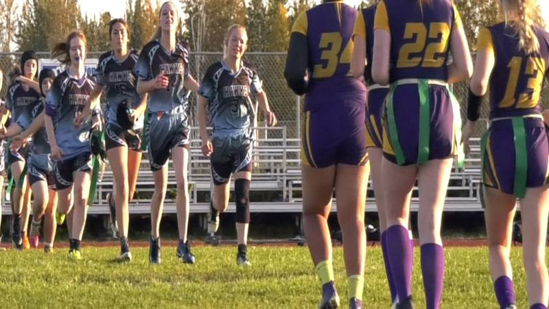 Lathrop and Hutchison get ready to shake hands after the Malemutes defeated the Hawks 30-0...