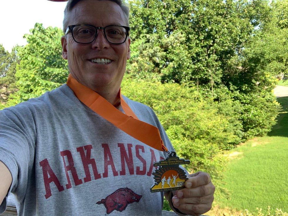 Chuck Lasley sports his Midnight Sun Run medal while representing Arkansas.