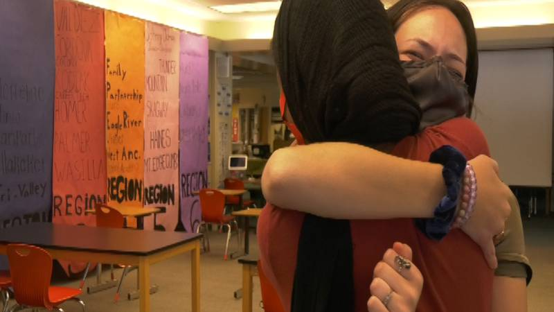 Asher Swan Adams hugs her classmate after an emotional conversation about the importance that...