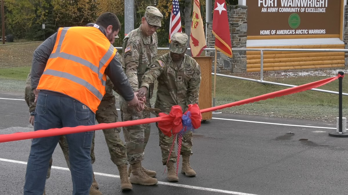 Soliders come together to cut the ribbon on Fort Wainwright