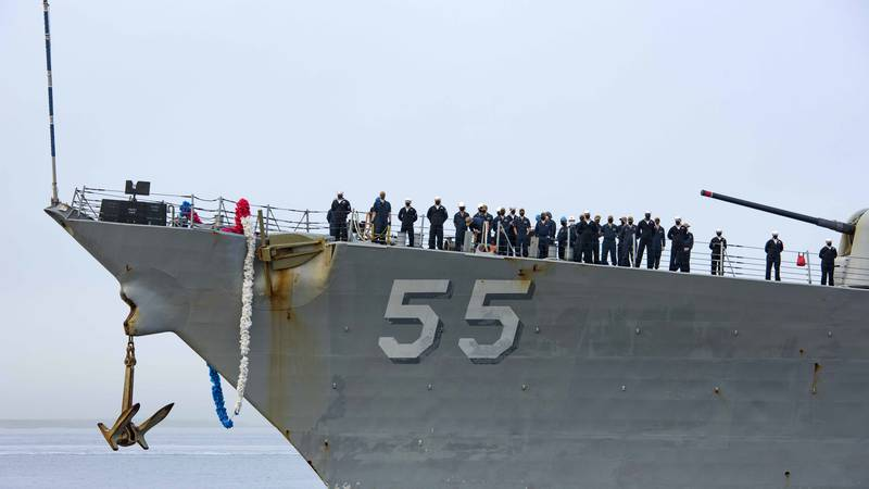 In this photo provided by the U.S. Navy, sailors aboard the guided missile destroyer USS Stout...