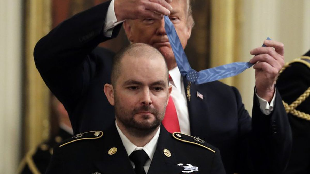 FILE - In this Oct. 1, 2018, file photo, President Donald Trump awards the Medal of Honor to former Army Staff Sgt. Ronald J. Shurer II for actions in Afghanistan, in the East Room of the White House in Washington. Shurer has died at age 41. Miranda Shurer said her husband, who was diagnosed with cancer three years ago, died Thursday, May 14, 2020, in a Washington, D.C., hospital. (AP Photo/Evan Vucci, File)