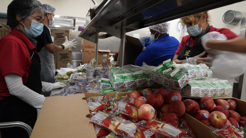 Los Angeles Unified School District food service workers from left, Tomoko Cho, Aldrin...