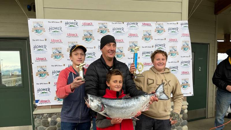 Andrew Marley (center) holding up his prize winning fish from the 2021 Homer Winter King...