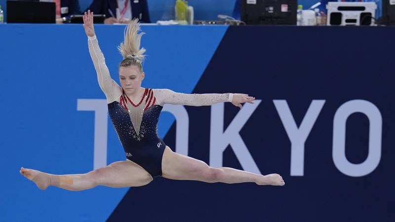 Jade Carey, of the United States, performs on the floor during the artistic gymnastics women's...