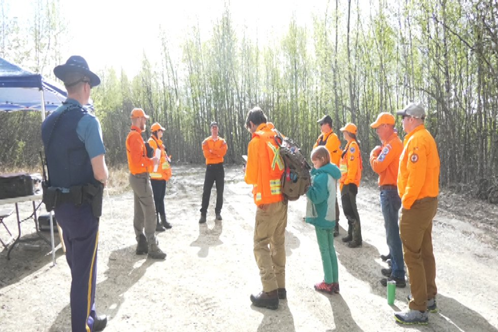 The Wilderness Search and Rescue volunteers met at the top of Ski Boot Hill Road to organize...