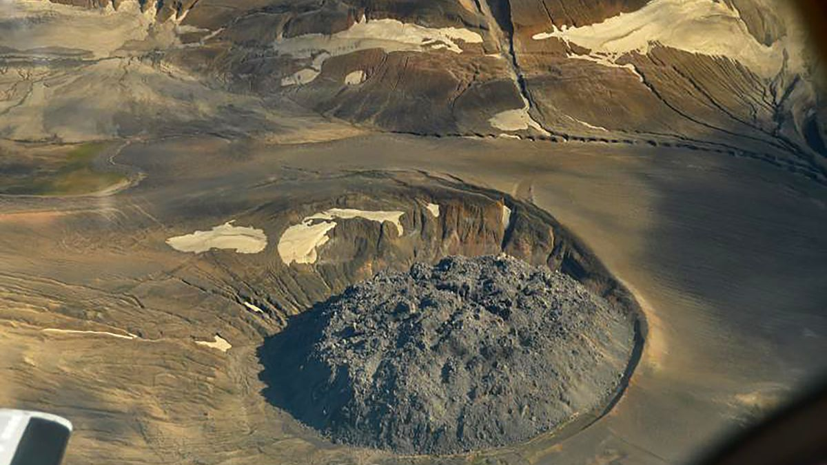 This Aug. 20, 2010 photo provided by the U.S. Geological Survey shows the lava dome named Novarupta marks the 1.2 mile (2 km) wide vent of the 1912 Novarupta-Katmai eruption. While western U.S. states were suffering from hazy red skies from wildfires, Alaska was dealing with an air quality problem born a century ago. Strong southerly winds picked up loose ash from a 1912 volcanic eruption, sending an ash cloud about 4,000 feet into the sky. (Peter Kelly/U.S. Geological Survey via AP)