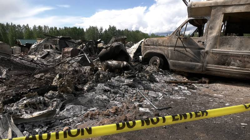 The remains of an RV and home that was burned to the ground on Saturday morning. Alaska State...