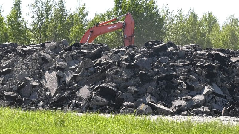 A pile of pavement is seen near Chena Hot Springs Road, crews are having to remove massive...