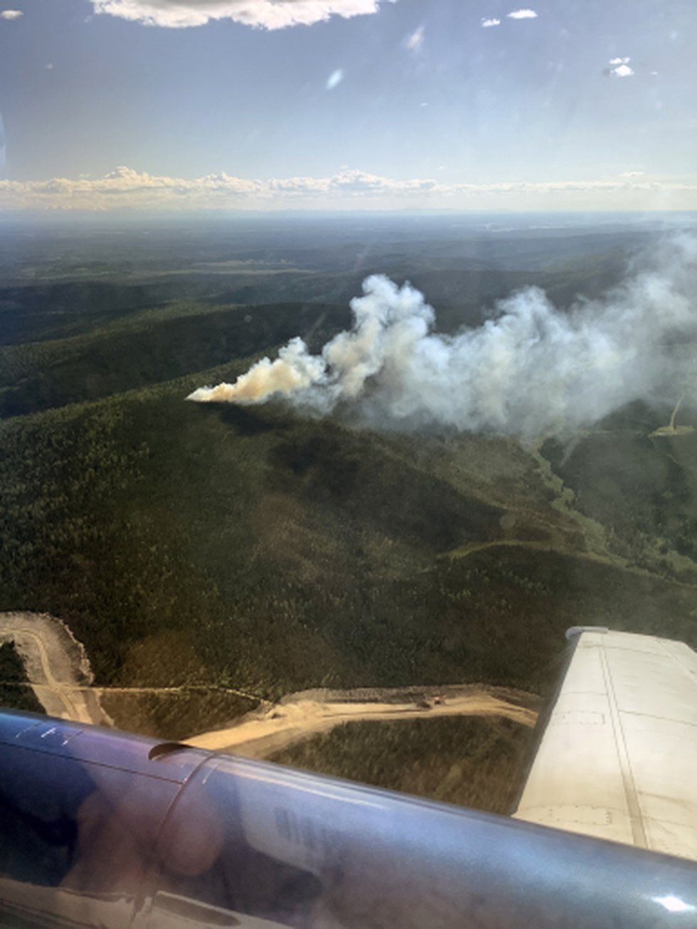 An aerial shot during initial attack of the 20-acre Winter Trail Fire (#194) burning about 20...