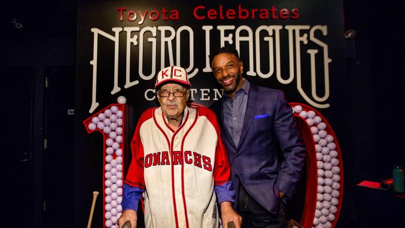 Negro Leagues Baseball Veteran, Jim Robinson, and ESPN/ABC correspondent, Ryan Smith, are seen...