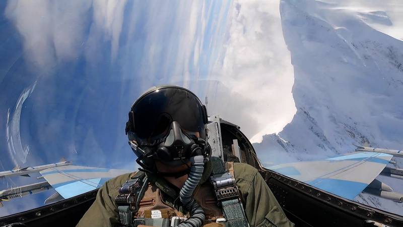 Our reporter John Dougherty gets up close with a mountain during a flight in an 18th Aggressor...