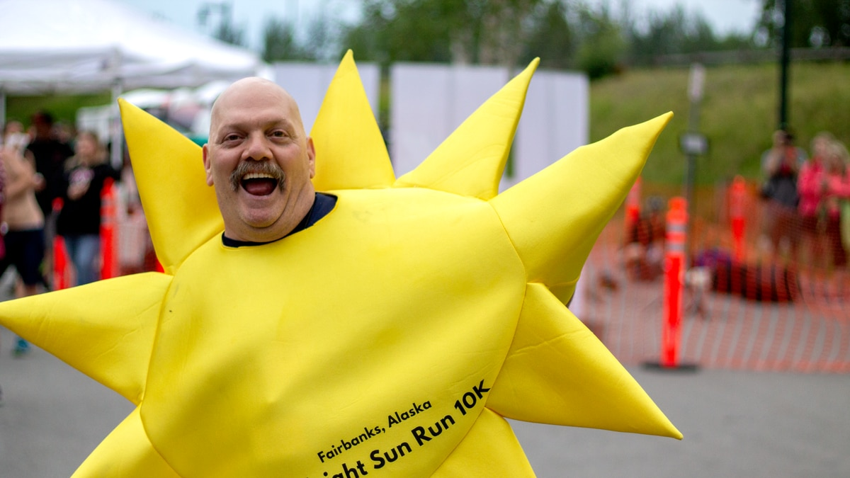The midnight sun mascot dances at the finish line of the 2019 Midnight Sun Run (Amanda Becker/KTVF)