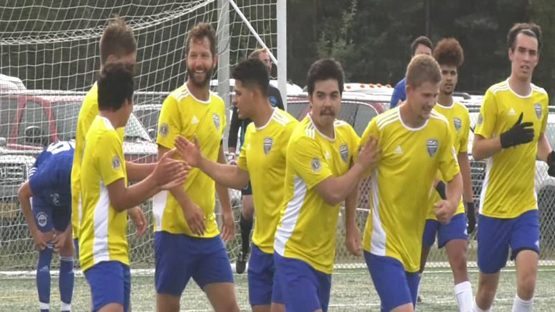 Fairbanks Soccer Club celebrates one of six goals in their victory over Pioneer United Saturday.