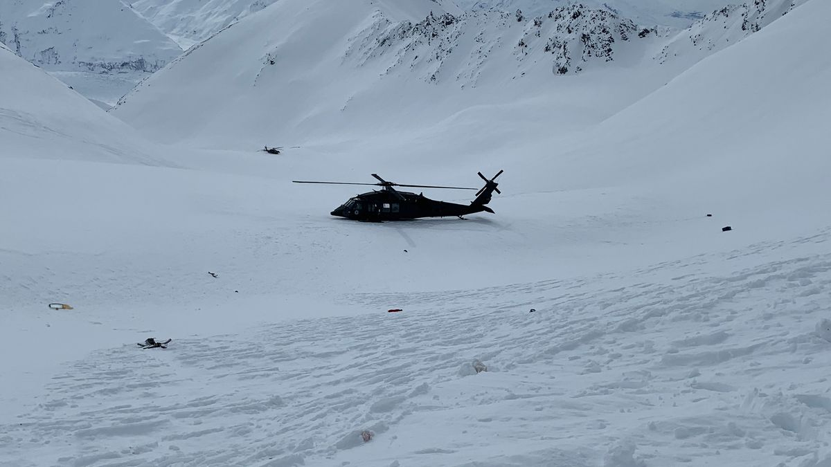 An Alaska Army National Guard helicopter near the crash site near Knik Glacier.
