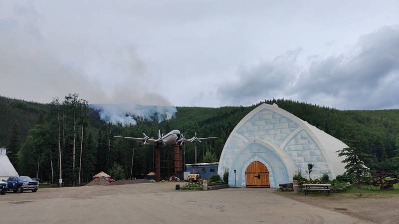 The Munson Creek Fire slowly creeps down the hill near the Chena Hot Springs Resort.