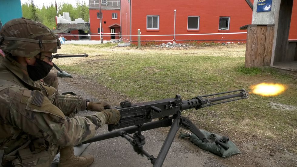 Second Lieutenant Justin Perry practices shooting a machine gun as he trains for the upcoming...