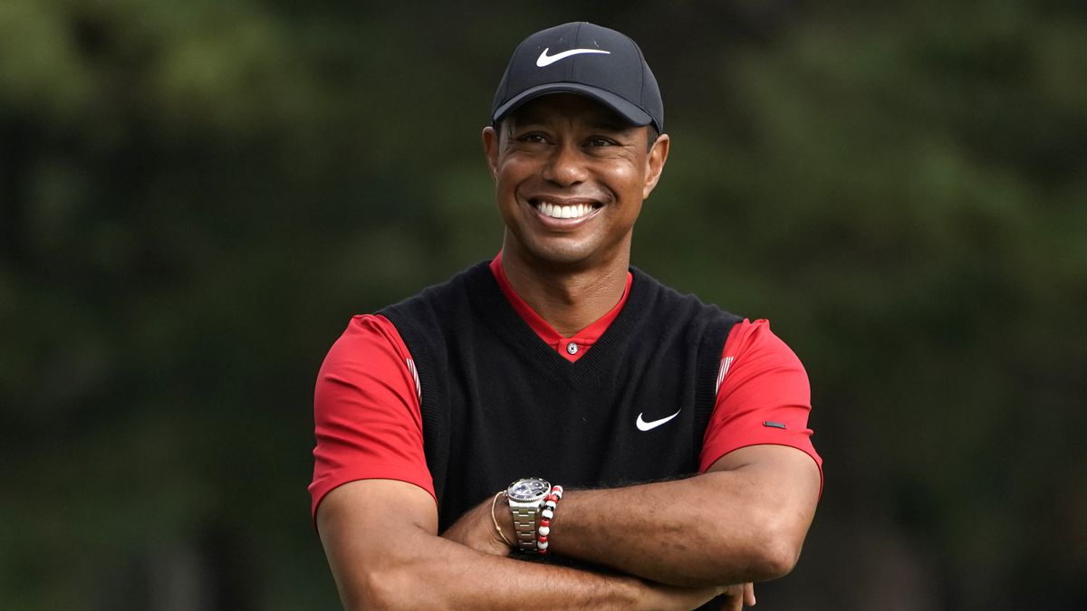 FILE - In this Oct. 28, 2019, file photo, Tiger Woods smiles during the winner's ceremony after...