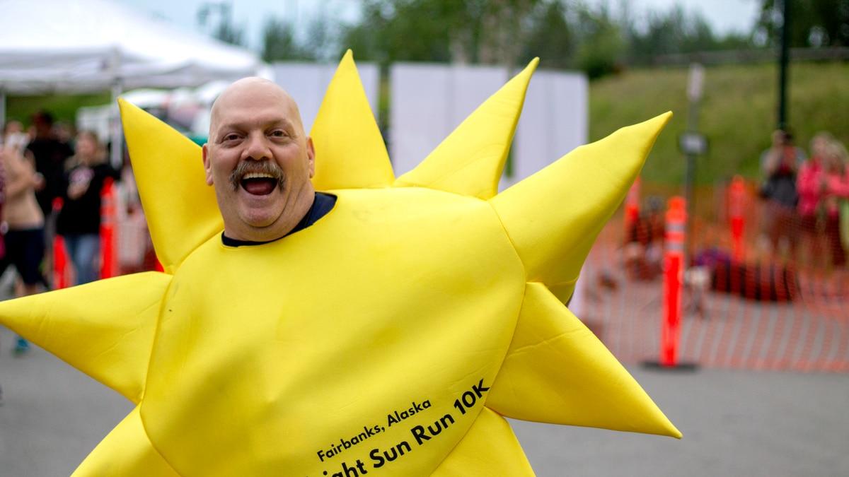 The midnight sun mascot dances at the finish line of the 2019 Midnight Sun Run (Amanda...