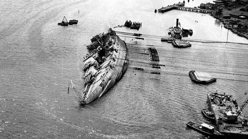 The USS Oklahoma, sunk in the Dec. 7, 1941 Japanese attack on Pearl Harbor, is shown here...