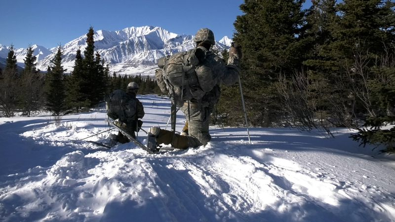 Soldiers from Team 2, the Automatics, conduct a recon exercise during the annual USARAK Winter...