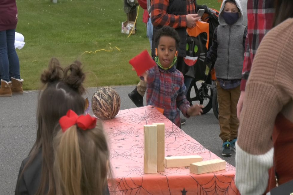 Children played games along the walkways of the Tanana Valley Fairgrounds Saturday afternoon.