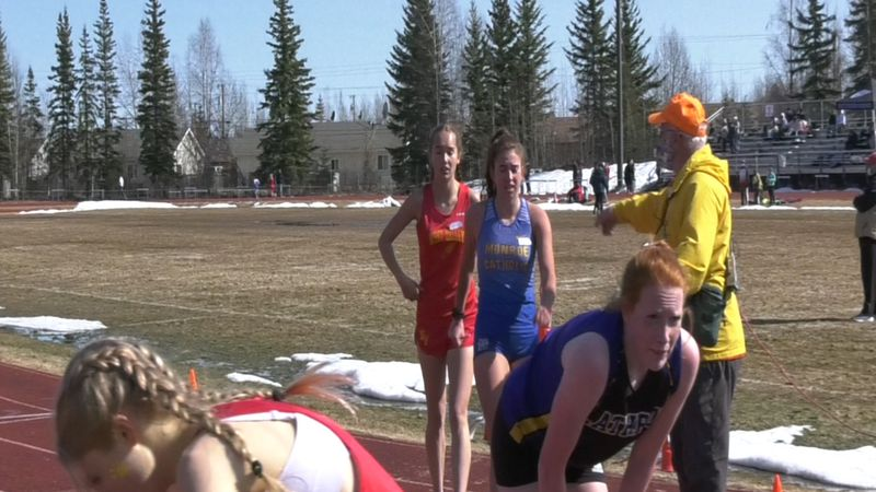 Runners complete the 1600-meter event at Saturday's Track & Field Meet in North Pole.