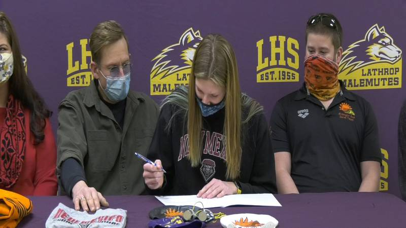 Katy McCarter signs her National Letter of Intent to the University of New Mexico swim team...