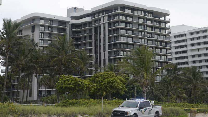 FILE - This Thursday, June 24, 2021, file photo, shows a sister building of a condominium that...
