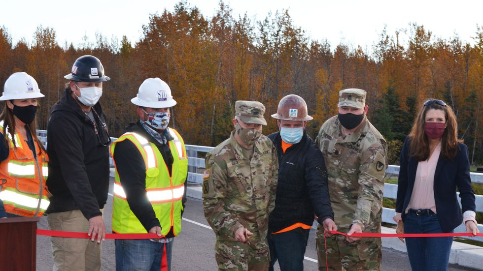 Cutting the ribbon marking the reopening of Bailey Bridge are prime contractor STG Pacific LLC representatives Candace White, Trenton Smith, and Josh James; U.S. Army Garrison Alaska Commander Col. Christopher Ruga; Hamilton Construction Company representative Tim Murphy; USAG Alaska Command Sgt. Maj. Robert Preusser and Deputy to the Garrison Commander Catherine Miller. (Photo by Grant Sattler, USAG Alaska, Fort Wainwright Public Affairs Office)