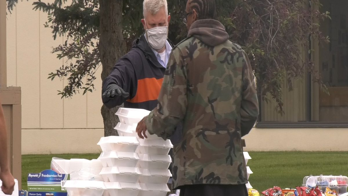 Local Veteran's receive their free meal at the annual Fairbanks Vet Center cookout. (Jordan Rodenberger/KTVF)