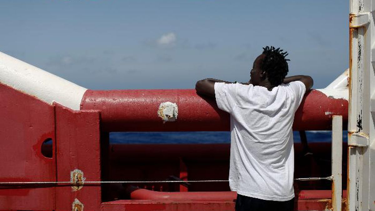 A man looks at the horizon from the Ocean Viking in Mediterranean Sea, Tuesday, Sept. 10, 2019. The humanitarian rescue ship operated by SOS Mediterranee and Doctors Without Borders, has requested Italian and Maltese authorities for the medical evacuation of a pregnant woman and a place of safety for the other 83 rescued migrants. (AP Photo/Renata Brito)
