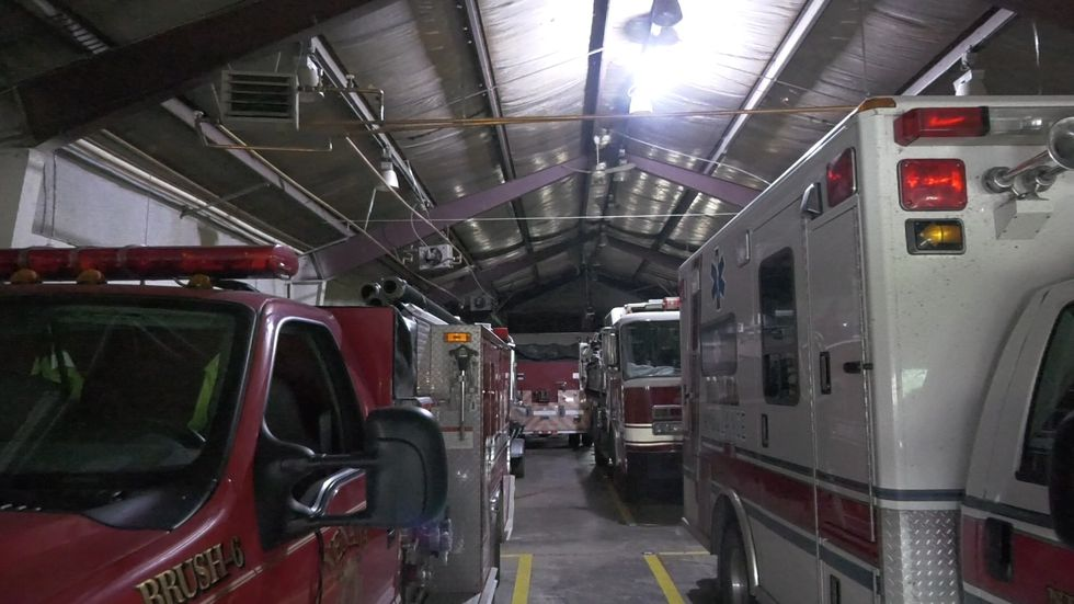 A single row of working lights illuminates the inside of the Nenana Fire Station.