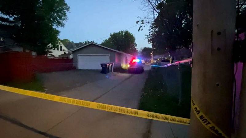 Police believe a four-door red Ford was driving in an alleyway when someone inside the vehicle...