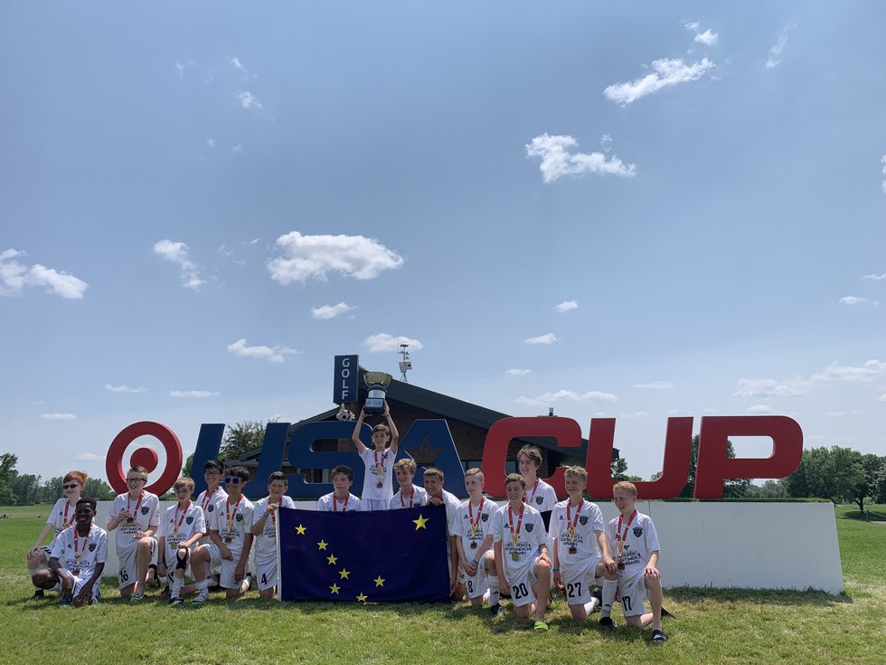 The Eclipse 08 Boys hoist the trophy at the Target USA Cup.