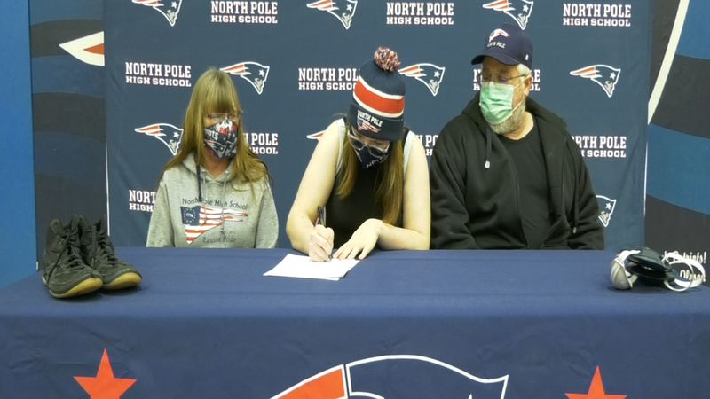 Megan Parrish (center) signed her National Letter of Intent to compete for Emmanuel College...