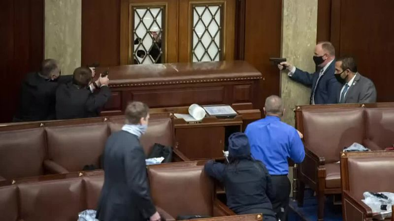 Capitol Hill security members work to protect the Senate chamber from rioters Wednesday.