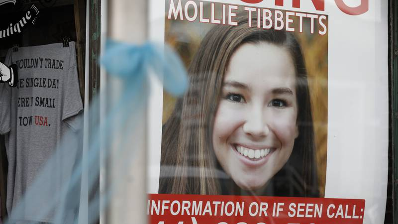 FILE - In this Aug. 21, 2018, file photo, a poster for missing University of Iowa student...