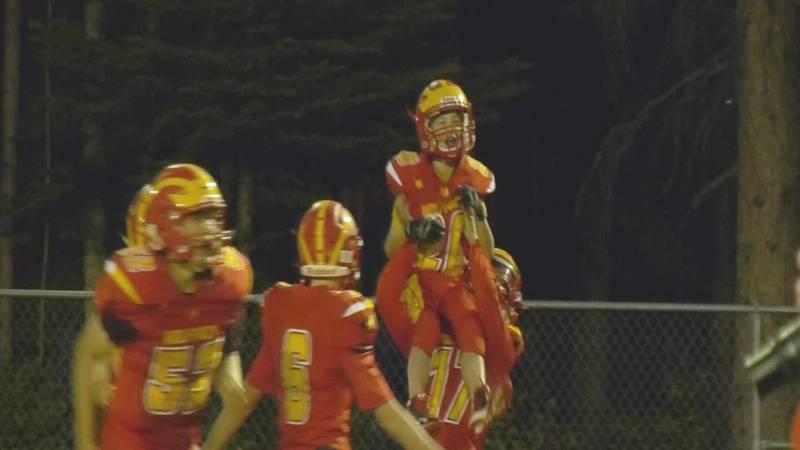 West Valley's Will Lowry-Sims (#17) uplifts Jacob Carlson (#26) following a 52-14 win over...