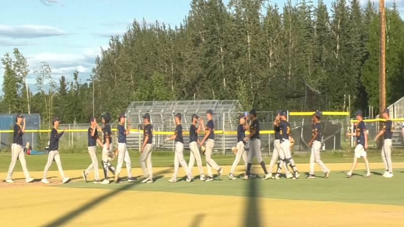 Alaska Goldpanners celebrate an 8-2 victory over the Everett Merchants Friday night.