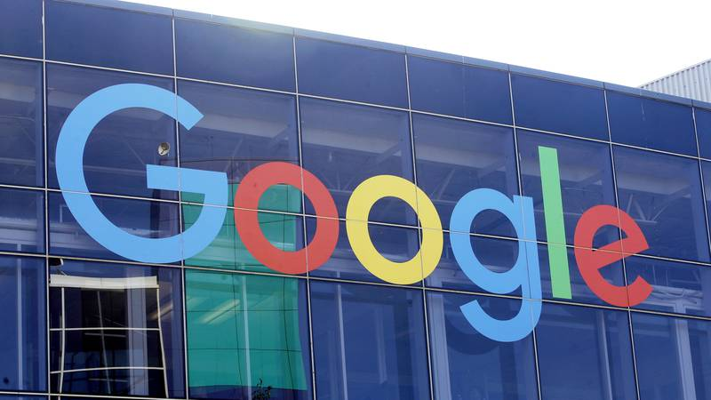FILE - In this Sept. 24, 2019 file photo, a sign is shown on a Google building at their campus...